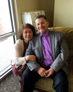 husband and wife take a photo together.