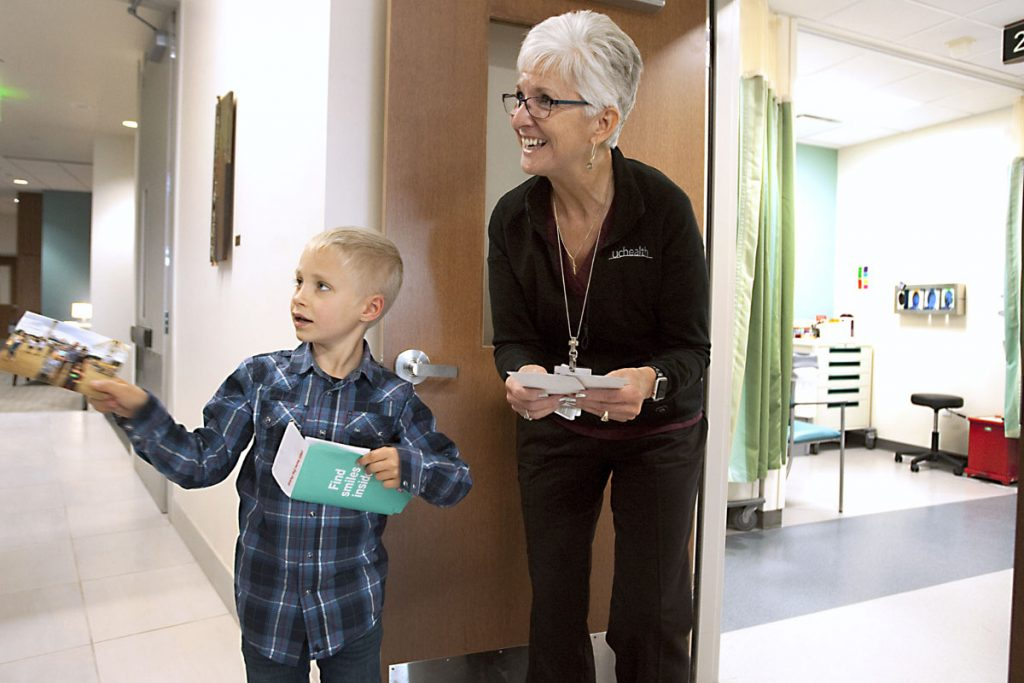Boy meets his friend the phlebotomist, sharing photos with her at the hospital.