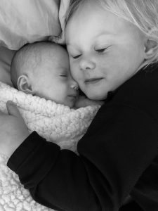 In this photo, Eddy McDaniel snuggles her baby sister, Mimi.