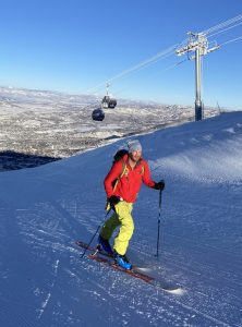 """In this photo, a skier """"skins"""" up the mountain on specialized equipment."""