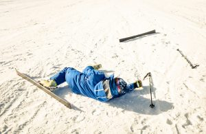 This photo shows a person who has fallen down on on a ski slope