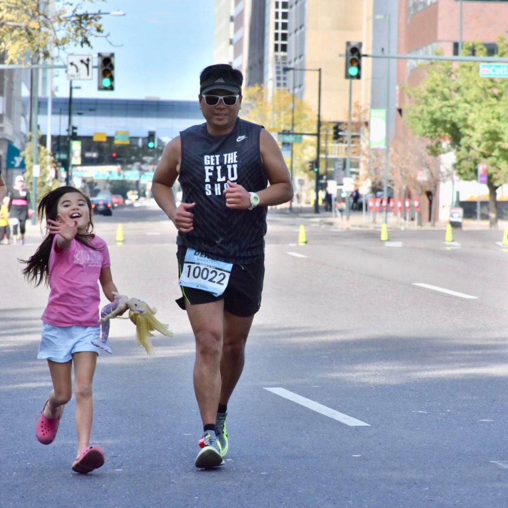 Victor running a 2015 Denver marathon after EMCO for acute respiratory distress syndrome saved his life. His 7-year-old daughter runs beside him.