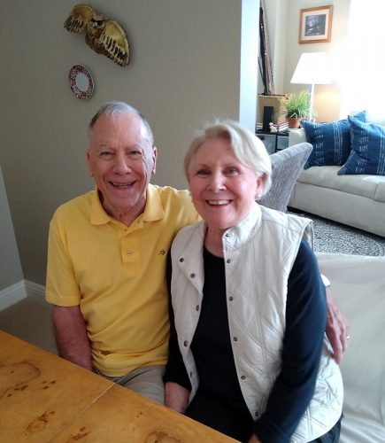 A couple smiles together, the husband who is living with dementia.