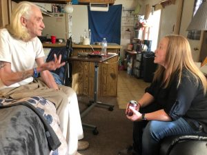 former patient and Hospital to Home program employee talk at trailer home in Colorado Springs.