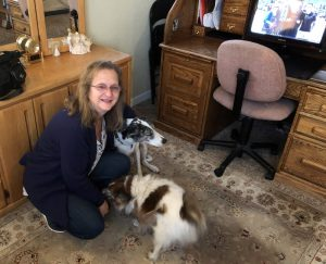 Julie Singles, who said a new procedure that helps in targeting breast tissue is much better than the old way, with her dogs.