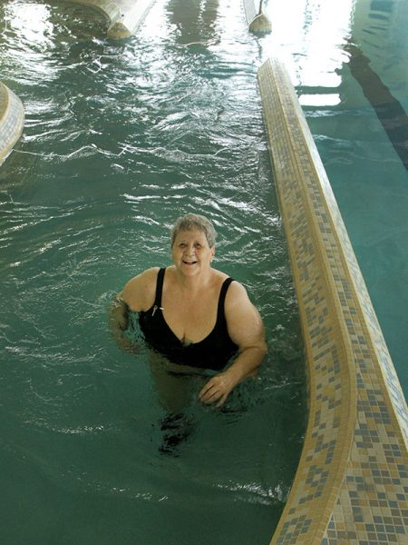 Margaret walks in the lazy river, a good prehabilitation for elective surgeries according to the Impact Clinic.