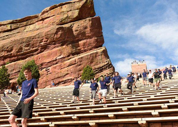 Marine recruits run down the bleacher seats at Red Rocks.
