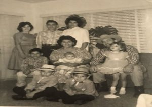 Old photograph of Jack Silva and his parents and seven siblings.