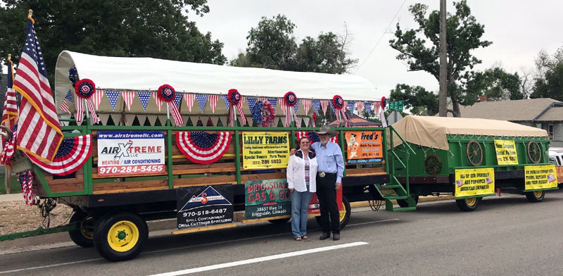 Jack, a heart disease patient, and his wife, Tina, stand in front of their patriotic parade float.