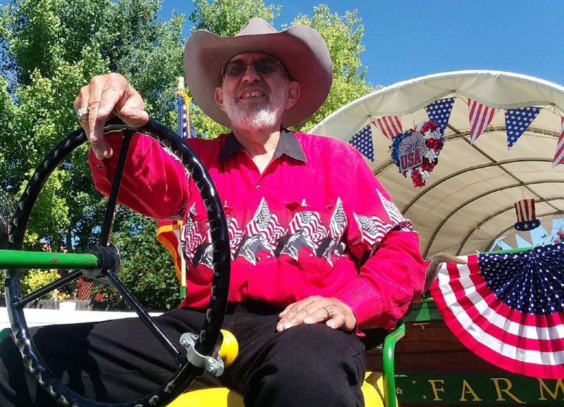 Jack Silva, a heart disease patient, driving a patriotic float in a local parade.