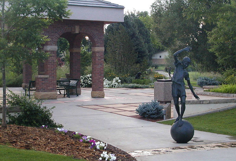 Pavilion and sculpture of girl balancing on a ball at Benson Scupture Garden, one of several great free things to do in northern Colorado.
