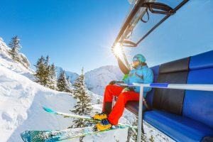 man on a chirlift, who can't ski anymore because of the outbreak of coronavirus at colorado ski areas closed them down.