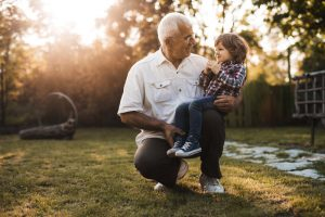 grandfather talking about coronavirus with a child.