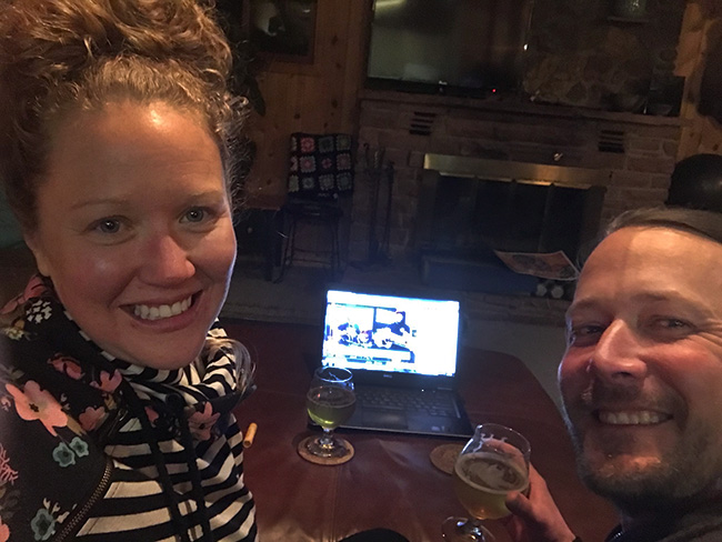 couple selfie of them watching live concert on their computer, one of the ways people are connecting during covid pandemic.