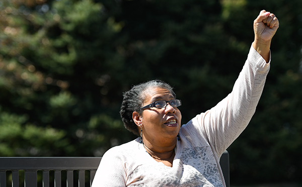 African American COVID-19 survivor, Ravi Turman, raised her hand in the air in the hospital after she learned she was the first in her unit to get off a ventilator.