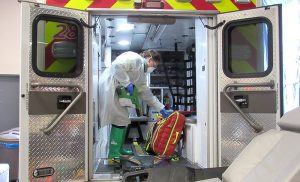 UCHealth specially trained employee uses an electrostatic sprayer as part of an disinfection process so EMS can be safe when responsing to medical emergencies during this pandemic.