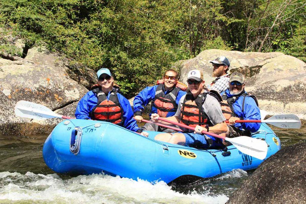 Lori Hopper rafts with friends.