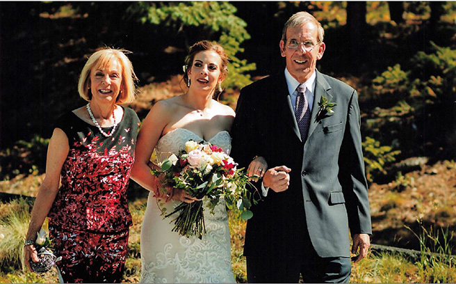 Dr. Michael Leonard, the first convalescent plasma patient leaves ICU, is pictured here with his wife, Meg, at their daughter, Molly's wedding.