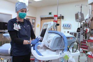 Nurse wipes down ventilator