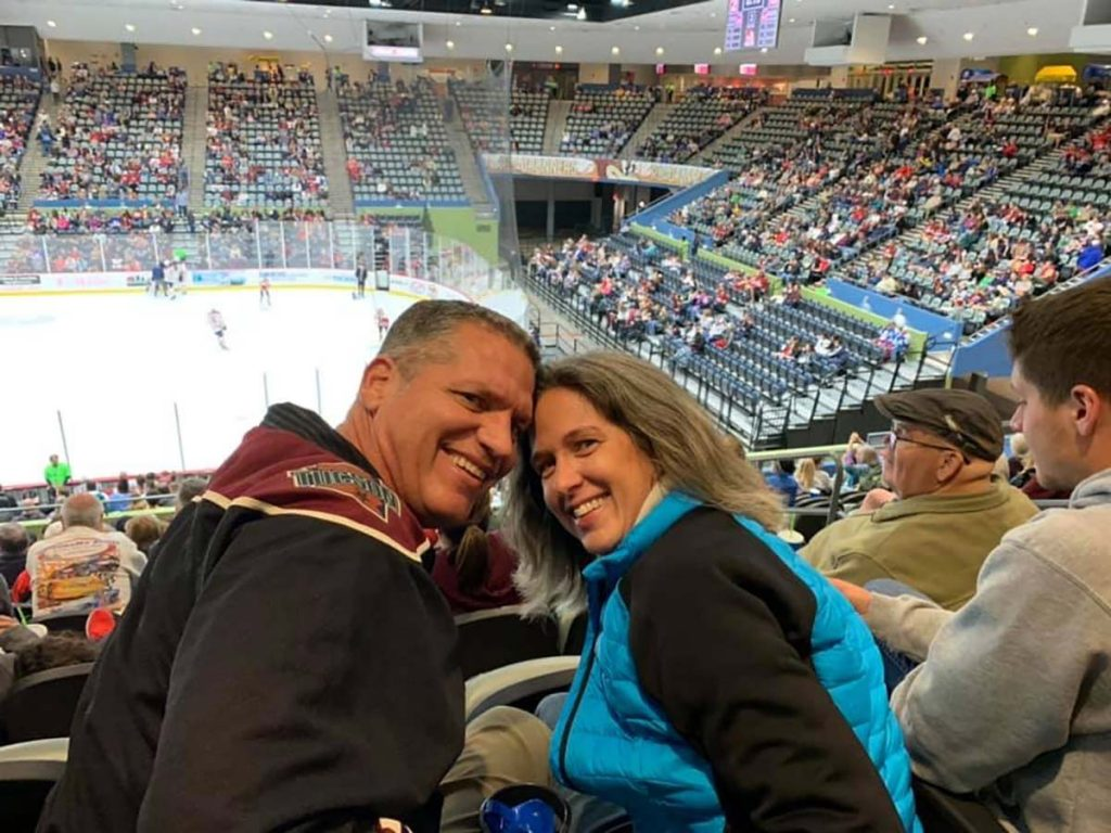 This couple from Tucson enjoy a hockey came