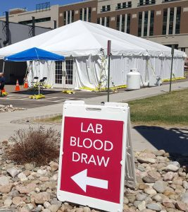 A photo of a tent on the campus of UCHealth Memorial Hospital Central where new drive-thru lab services in Colorado are available.