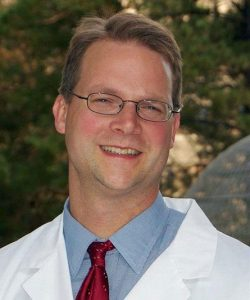 profile shot of a doctor who is leading a study to test effectiveness of a blood pressure drug to fight pancreatic cancer.