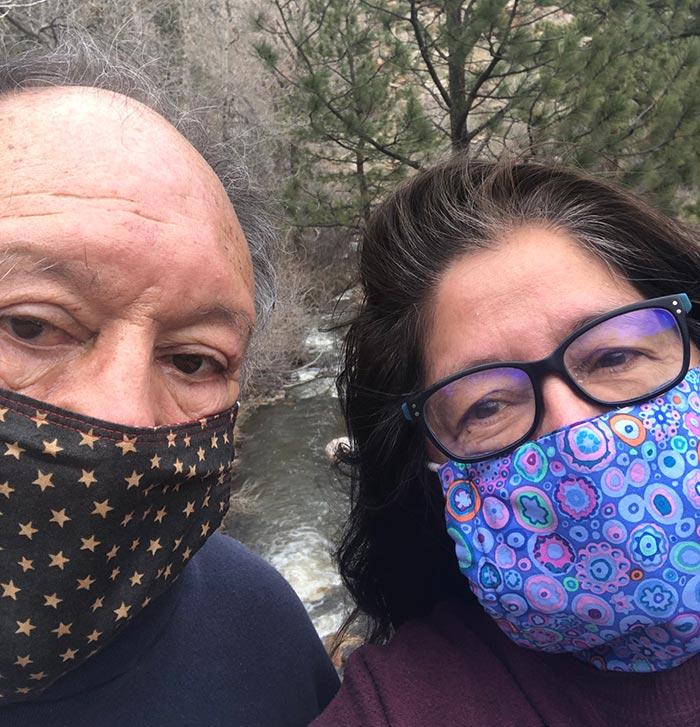 selfie of sam and paula wearing masks on a hike