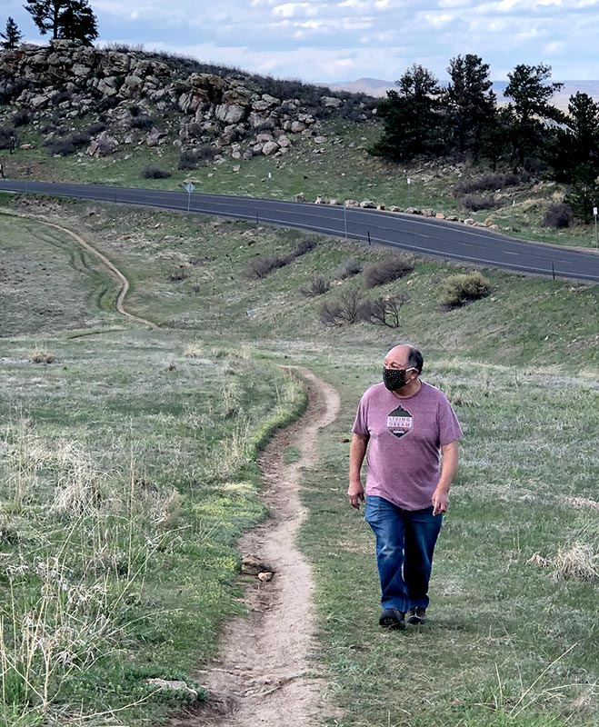 Sam walking along a trail at Horsetooth reservoir after going to the ER for chest pains and undergoing a quadruple bypass.