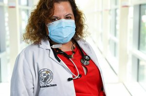 Headshot of Dr. Michelle Barron. After getting a COVID-19 vaccine, people should keep wearing masks until millions of others also get vaccines.