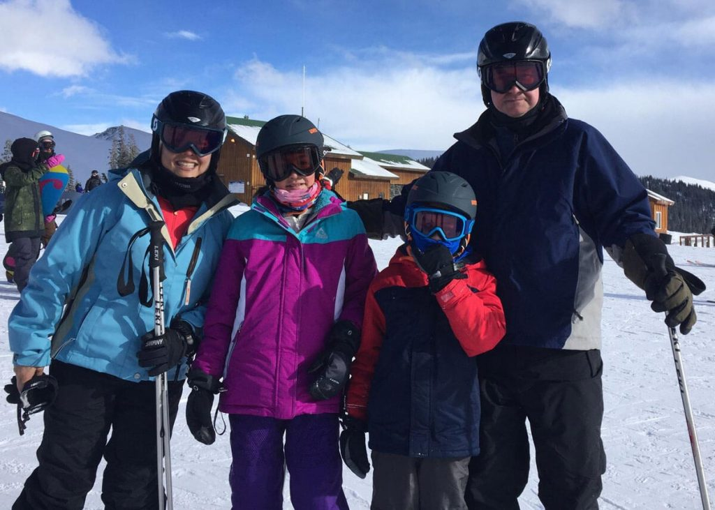 Kim Tyler with daughter Ainsley, son Andon, and husband Alejandro on the slopes. Kim hurt herself on the slopes and then her ACL repair was delayed because of the coronavirus.