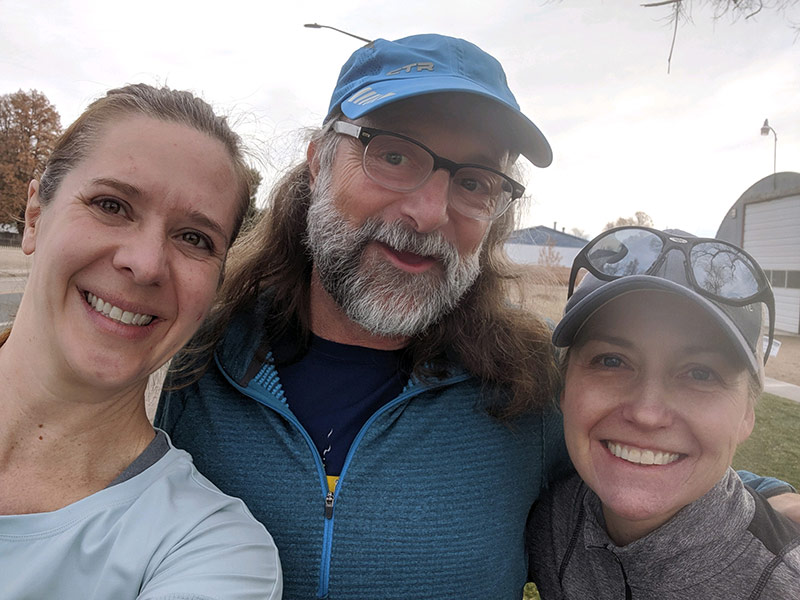 Jeff with his two therapists, who helped him with his hemorrhagic stroke treatment, after a Sunday run