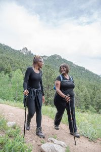Camping in Colorado durnig COVID-19 can be a great escape. Here, two women hike in Golden Gate Canyon State Park.