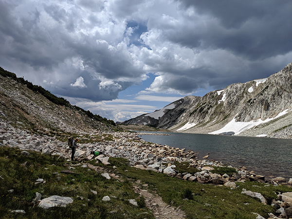 Camping in Colorado durnig COVID-19 can be a great escape. Photo of Dr. Nancy Madinger backpacking in the Snowy Range in Wyoming.