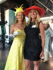 two women dress up at a fundraiser event.