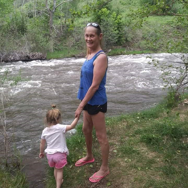 pamela, who had Ureteral reconstruction, with her granddaughter at a river.