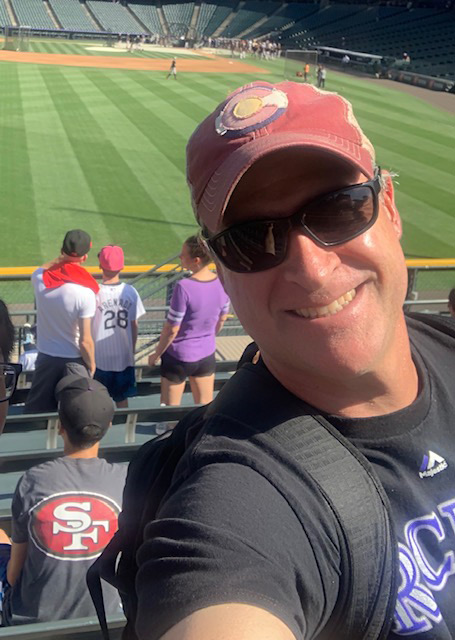 Dr. Matthew Purvis at a Colorado Rockies game
