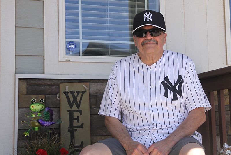 Sal sitting on his front porch with his yankee's jersey and hat on, a few weeks before getting off blood thinners entirely..