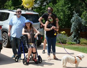 ECMO treatments for COVID-19 helped Barbara Gould survive. Here, she sits in her driveway after arriving home.