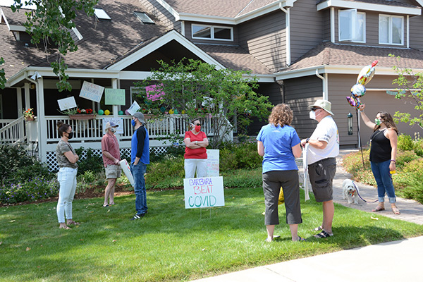 well-wishers gather to welcome Barbara Gould home
