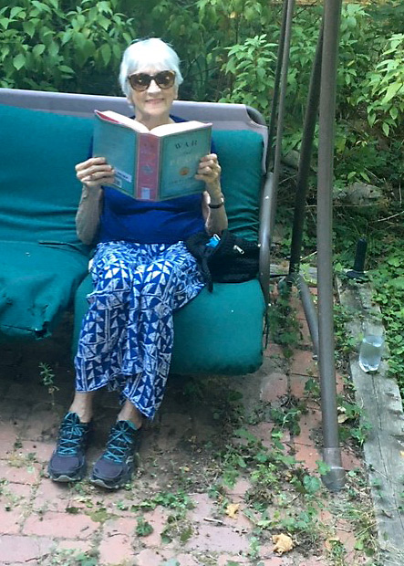 Claire, after TAVR addressed her severe aortic stenosis, enjoying War and Peace during the coronavirus pandemic.