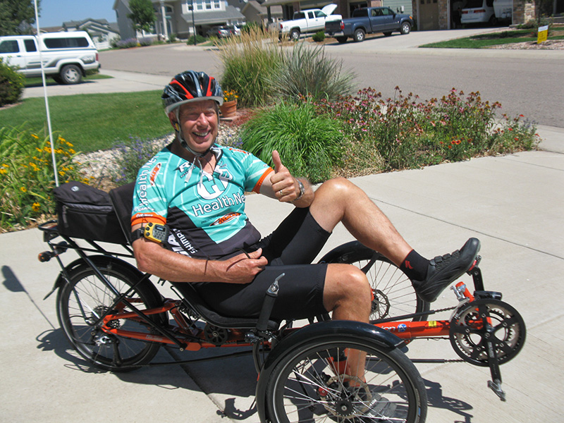 Dave on his trike giving a thumbs up. getting out to do something you enjoy is one tool for caregivers.