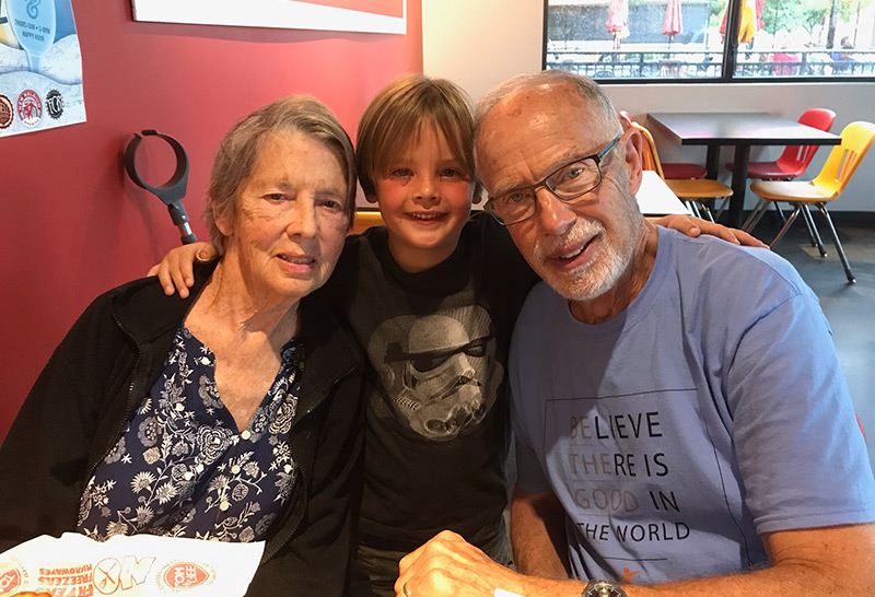 Dave, Loni and in the middle, their young grandson. his powerful tools for caregivers class made him reach out more to family for help.