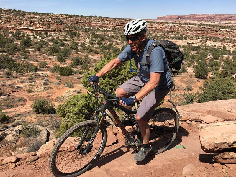 black on his bike in in Moab after his first hip replacement.
