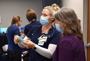 Nurses look at computer monitors in the newly renovated wing of PVH.