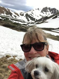 breast cancer survivor Cherry Creek. Mary White poses in the mountains with her dog, Buddy.
