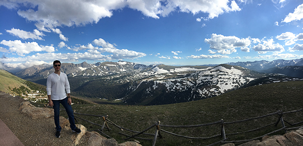 allergy specialist central denver. Dr. Rebin Kader loves mountains. Here he poses on Trail Ridge Road in Rocky Mountain National Park.