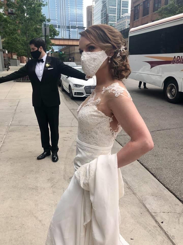 plastic surgery expert Cherry Creek. Dr. Rebekah Zaluzec in her wedding gown with a white lace mask.