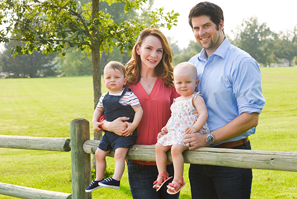 Dr. Rebekah Zaluzec is a plastic surgery expert in Cherry Creek. Here she poses with her husband and their twins.
