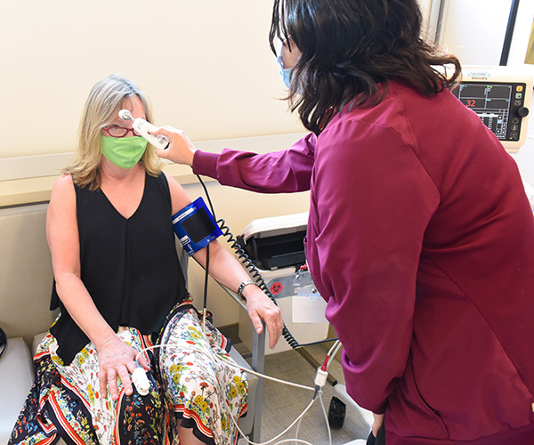 Mary White, breast cancer survivor, gets injections in Cherry Creek at the new UCHealth multi-specialty center