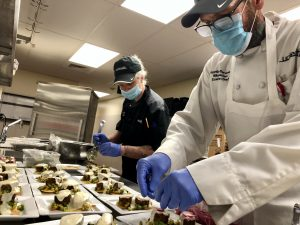 Executive Chef Charters plates second course of meal
